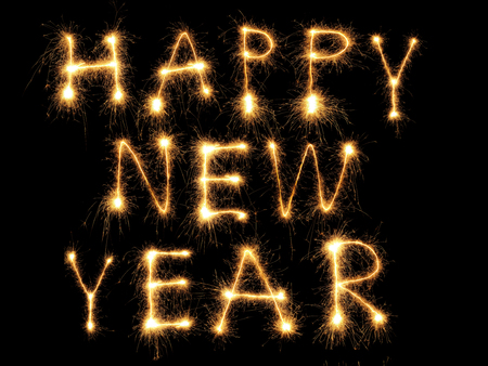 new year  s day: Happy New Year formed from sparking letters over black background