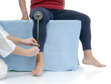 lower limb: Physiotherapist measuring active range of motion of older patients lower limb using manual goniometer Stock Photo
