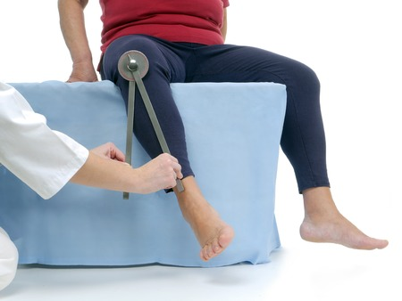 flexion: Physiotherapist measuring active range of motion of older patients lower limb using manual goniometer Stock Photo