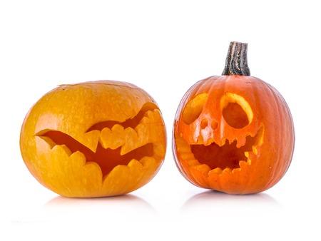 2 november: Two Jack-o-lantern pumpkin with carved patterns shot on white background