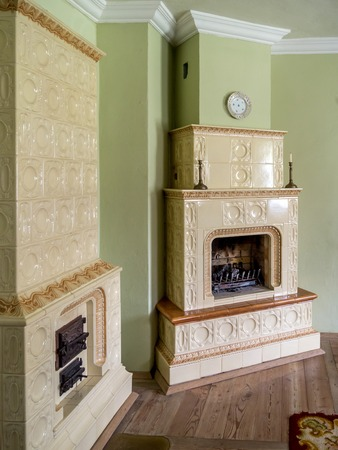 tiled stove: Retro style room with two tiled stoves Stock Photo
