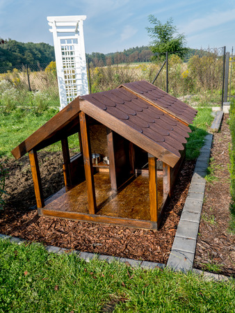 Wooden kennel in the backyard photo