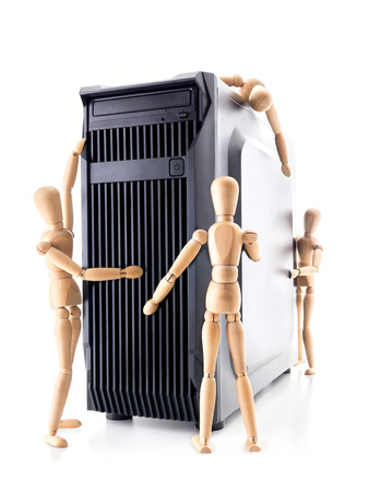 wooden mannequin: New server station being inspected by four wooden dummies shot on white Stock Photo
