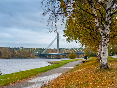 rovaniemi: Park alley in autumn colors with bridge over the river in the background, Rovaniemi, Finland