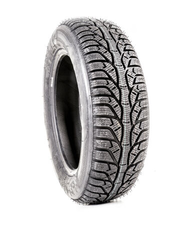 servicing: Winter car tyre shot on white