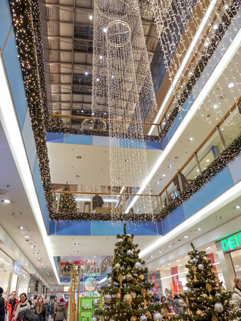 KRAKOW, POLAND - DECEMBER 19 2013: Galeria Krakowska Shopping Center decorated with christmas trees and ornaments, Krakow, Poland