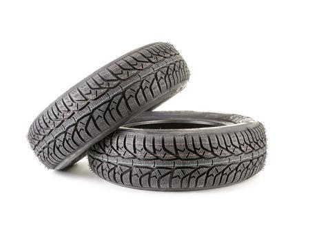 Pair of winter car tyres shot on white photo