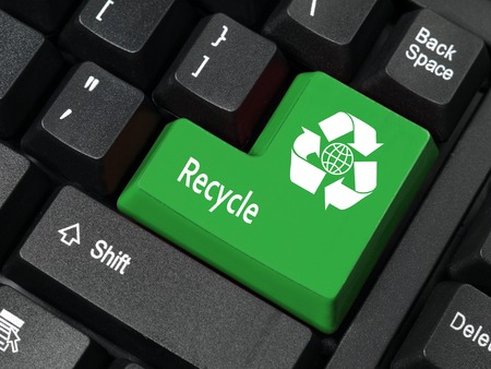 key words: Closeup of computer keyboard key in green color with three-arrow recycle and earth symbol and Recycle word