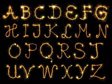Spark alphabet over black background photo