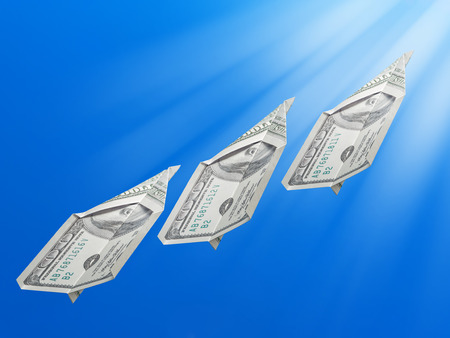 business metaphore: American one hundred dollar banknotes folded into toy planes rising up towards the Sun Stock Photo