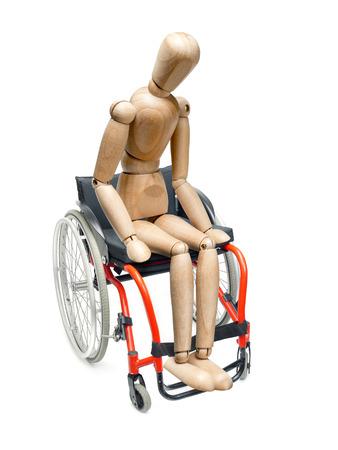 wooden mannequin: Wooden dummy sitting on wheelchair on white background