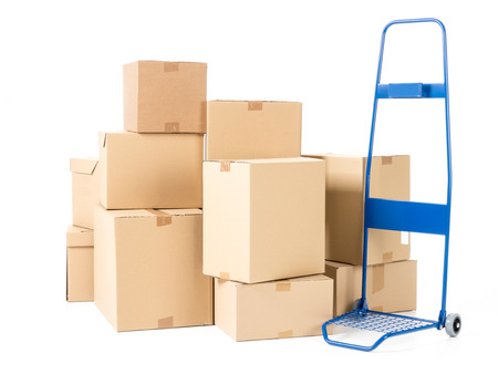 hand truck: Hand truck and pile of cardboard boxes on white background