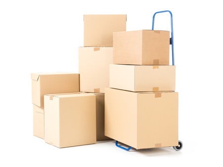 stockpiling: Hand truck and pile of cardboard boxes on white background