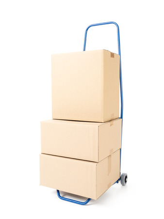 stockpiling: Pile of cardboard parcels loaded on hand truck on white background Stock Photo