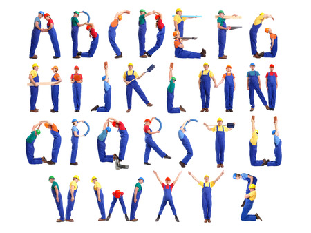 Alphabet formed from young people wearing industrial uniforms and helmets posing with various tools and accessories photo