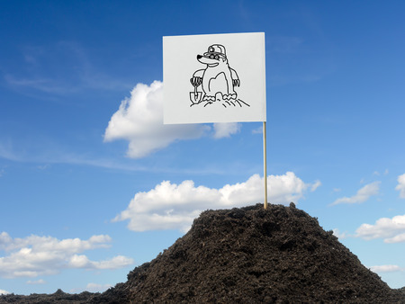 affixed: Mole mound with white flag showing mole icon affixed over blue sky