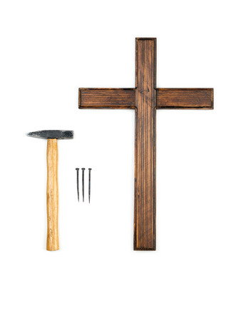 doityourself: Wooden empty cross, hammer and three nails - do-it-yourself crucifying concept Stock Photo