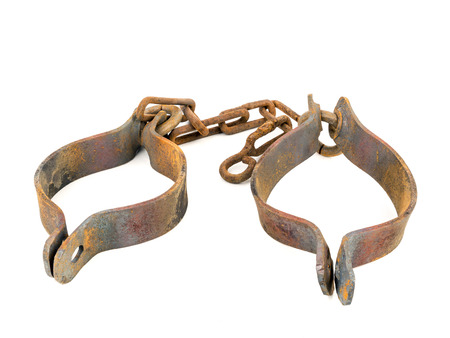 shackles: Old rusty handcuffs isolated on white