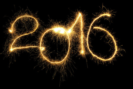 sparking: New Year 2016 formed from sparking digits over black background