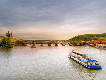 river: Panoramic view of Charles Bridge and Tower over the Vltava river in Praque,Czech Republic