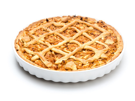 Apple pie in white ceramic pan on white background