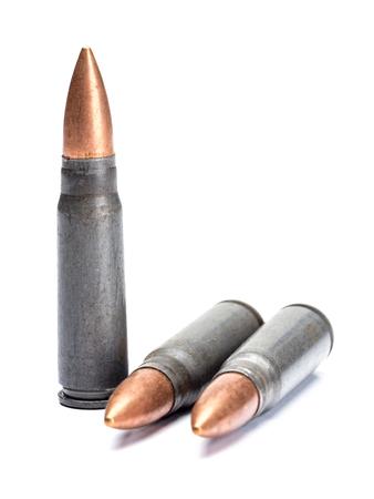 gunshot: Three rifle bullets shot on white Stock Photo