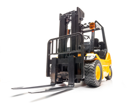 Yellow forklift truck shot on white background