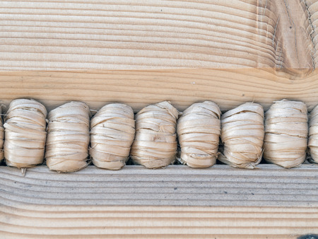 sealant: Closeup of wooden cabin wall with hemp rope sealant Stock Photo