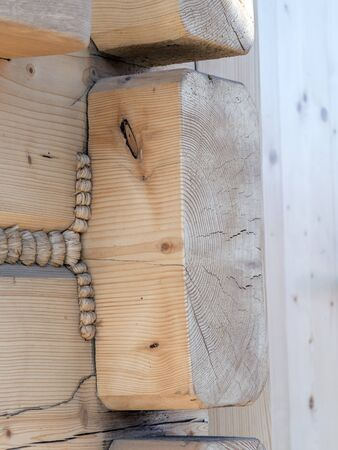 sealant: Closeup of wooden cabin wall corner joints with hemp rope sealant Stock Photo