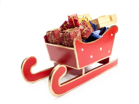 sackful: Red sleigh full of christmas presents over white background Stock Photo