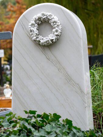 White marble tombstone at the catholic cemetary Фото со стока