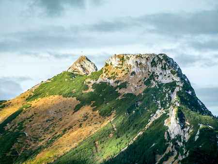 giewont: Mount Giewont in beautiful autumn colors seen from the alpine trail in the Tatra mountains, Poland