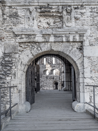 upland: The entry gate of the ruins of medieval castle Ogrodzieniec, located on the Trail of the Eagles Nest within the Krakow-Czestochowa Upland, Poland