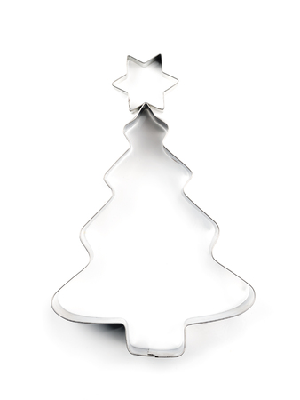 holiday tradition: Christmas tree-like metal cookie cutter on white background