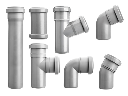 Assorted PVC sewage pipe fittings shot on white
