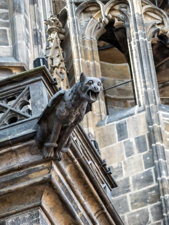 gargoyles: One of many stone demon gargoyles as a part of Metropolitan Cathedral of Saints Vitus, Wenceslaus and Adalbert, Prague Castle, Czech Republic