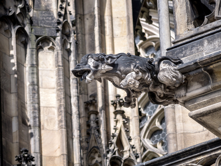 chimera: One of many stone demon gargoyles as a part of Metropolitan Cathedral of Saints Vitus, Wenceslaus and Adalbert, Prague Castle, Czech Republic