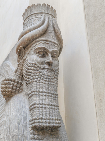 PARIS, FRANCE - AUGUST 28 2013: - Closeup of Winged Assyrian Bull Head, Khorsabad, representing benevolent spiritual guardians part of Ancient Mesopotamian history exhibited in Louvre Museum