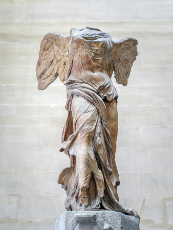showpiece: PARIS, FRANCE - AUGUST 28 2013: Winged Victory of Samothrace, also called Nike of Samothrace, marble sculpture exhibited in Louvre Museum