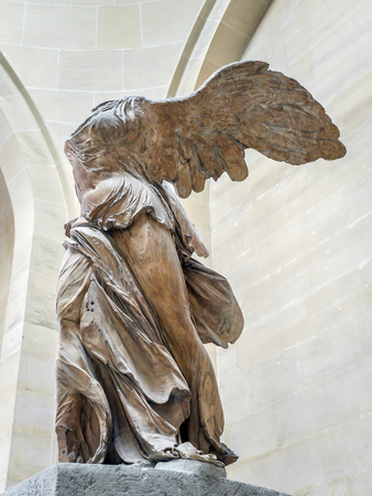 nike: PARIS, FRANCE - AUGUST 28 2013: Winged Victory of Samothrace, also called Nike of Samothrace, marble sculpture exhibited in Louvre Museum