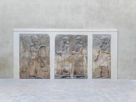 mesopotamian: PARIS, FRANCE - AUGUST 28 2013: Relief in Cour Khorsabad courtyard - part of Ancient Mesopotamian history exhibited in Louvre Museum Editorial