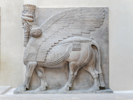 history: PARIS, FRANCE - AUGUST 28 2013: Relief in Cour Khorsabad courtyard - part of Ancient Mesopotamian history exhibited in Louvre Museum Editorial