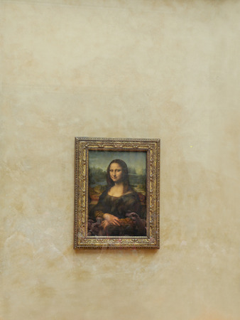 priceless: PARIS, FRANCE - AUGUST 28 2013: - Leonardo Da Vincis famous portrait of Mona Lisa exhibited at the Louvre Museum