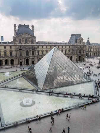 ile de france: PARIS, FRANCE - AUGUST 28 2013: - The main courtyard of the Louvre Museum with the glass Pyramid Editorial