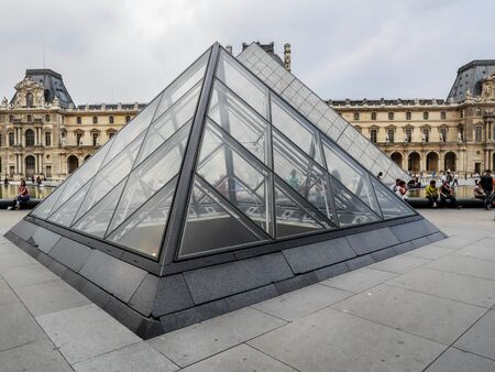 louvre pyramid: PARIS, FRANCE - AUGUST 28 2013: - The main courtyard of the Louvre Museum with the glass Pyramid Editorial