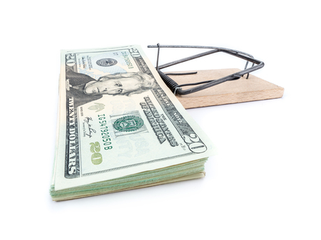 mouse trap: Mouse trap with 20 dollar bill pile attached as bait on whiite background Stock Photo