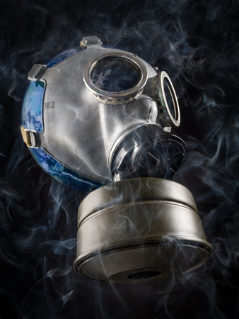 suffocation: Planet Earth with gas mask as a metaphore of global air pollution