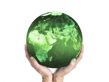 harmless: Green Planet Earth being supported by female hands. Some elements of this image taken from NASA archive Stock Photo