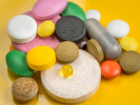 sorts: All sorts of drugs over yellow background Stock Photo