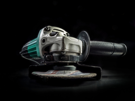 angular: Angular grinder on black background